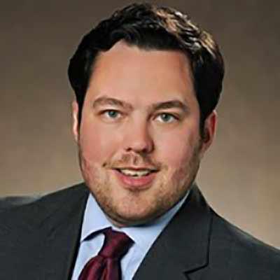 A portrait photo of Patrick Pratt